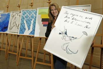 "Artist Tracey Emin poses with her Paralympic poster ""Birds 2012"" at the unveiling ceremony of the official Olympic and Paralympic posters for London 2012 at the Tate Britain gallery in London November 4, 2011."