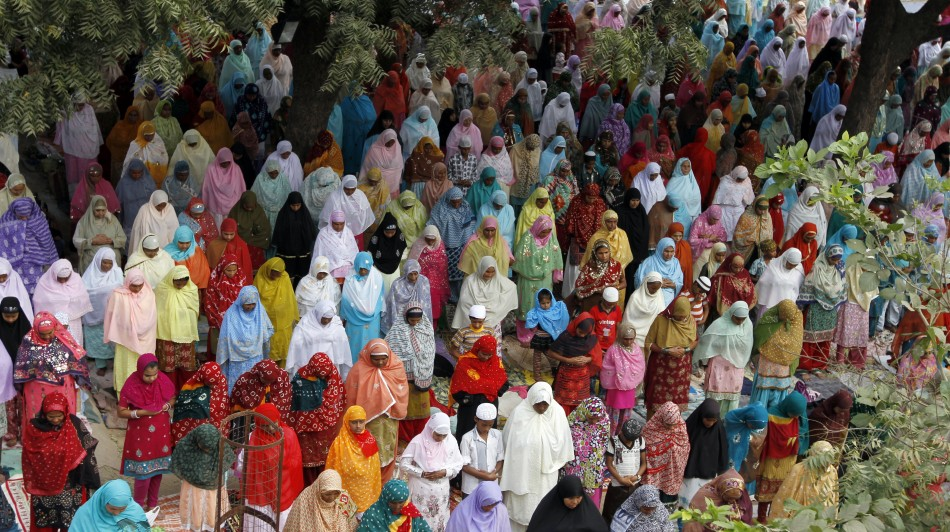 Muslim women offer prayers at a mosque on the eve of the Eid al-Adha festival on the outskirts of the western Indian city of Ahmedabad