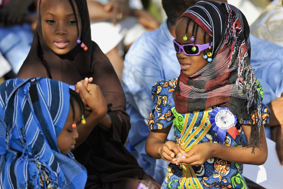 Girls attend prayers marking the Muslim festival of Eid al-Adha in the Nigerian capital, Abuja