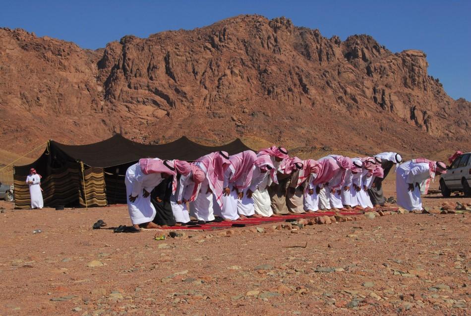 People pray in Ashwaq village on the occasion of Eid al-Adha near the city of Tabuk, Saudi Arabia