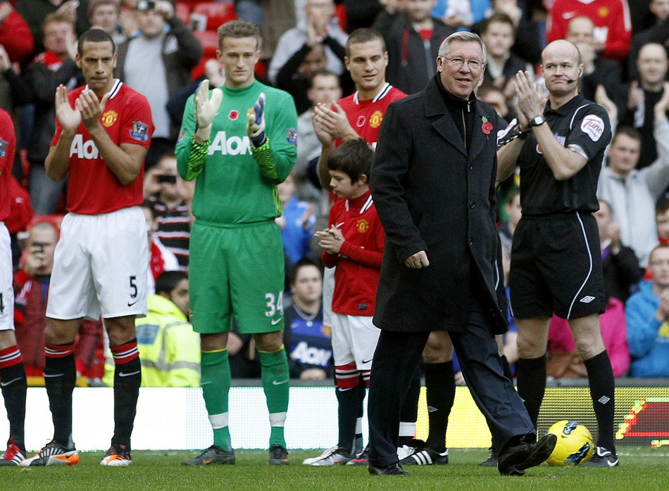 Manchester United's manager Alex Ferguson is given a guard of honour to mark his 25th year as manager before their English Premier League soccer match against Sunderland in Manchester
