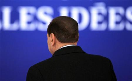 Italy's PM Berlusconi is seen from the back as he arrives for the second day of the G20 Summit in Cannes