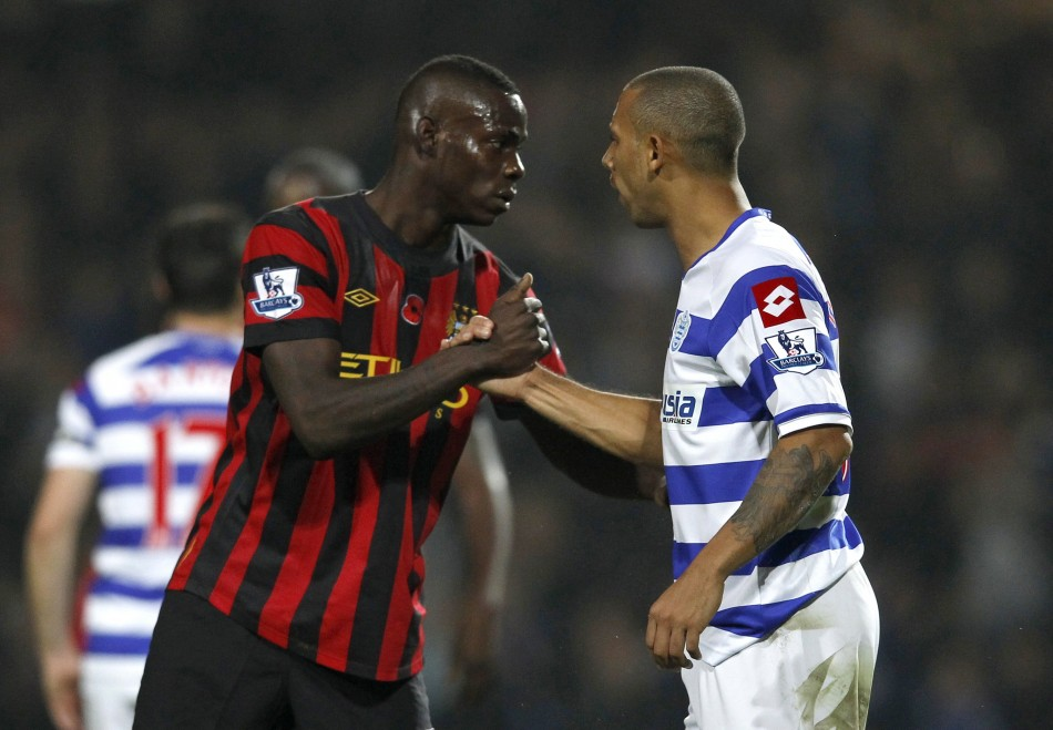 Queens Park Rangers' Anton Ferdinand shakes hands with Manchester City's Mario Balotelli after their English Premier League soccer match in London