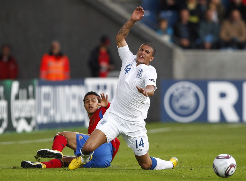 England's Kyle Walker is fouled by Spain's Thiago Alcantara during their European Under-21 Championship soccer match in Herning