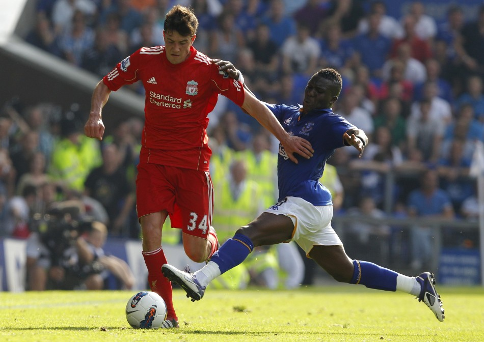 Everton's Drenthe challenges Liverpool's Kelly during their English Premier League soccer match in Liverpool