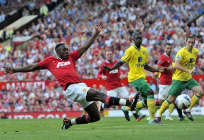 Manchester Uniteds Welbeck stretches for a shot during their English Premier League soccer match against Norwich City in Manchester