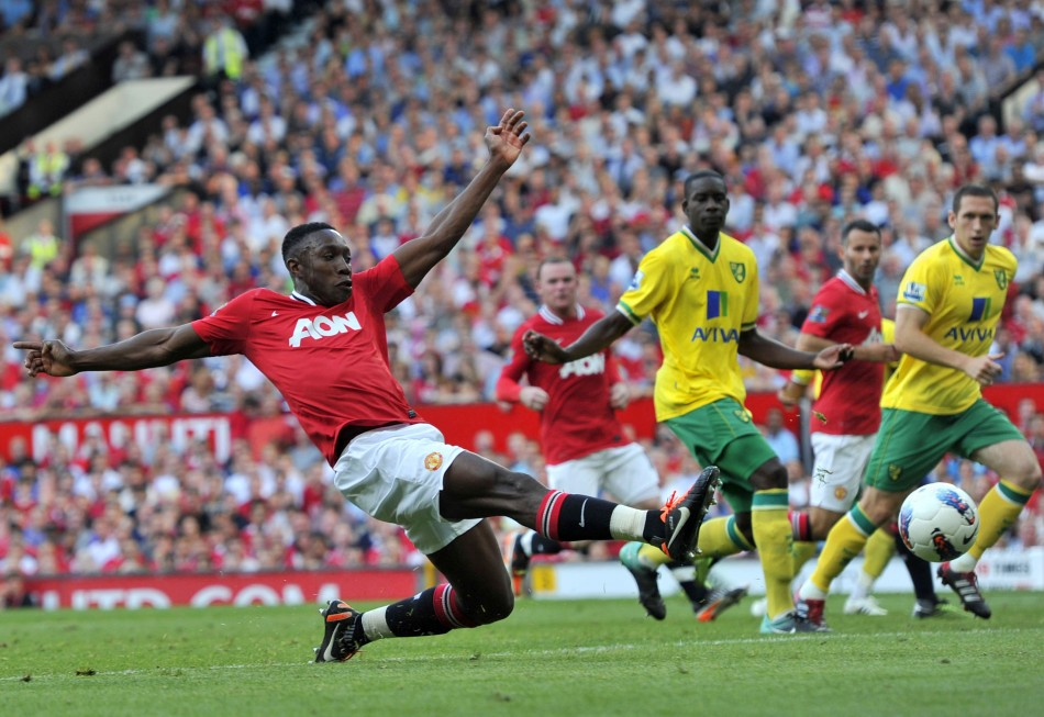 Manchester United's Welbeck stretches for a shot during their English Premier League soccer match against Norwich City in Manchester