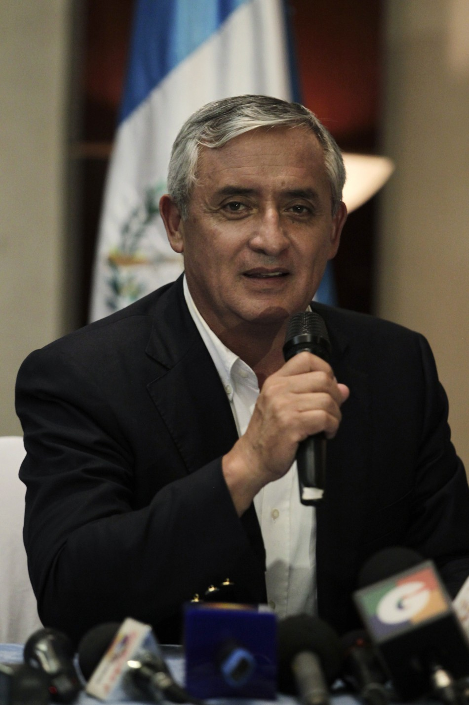 Retired general Otto Perez of the right-wing Patriot Party speaks in the media center of the Supreme Electoral Tribunal in Guatemala City