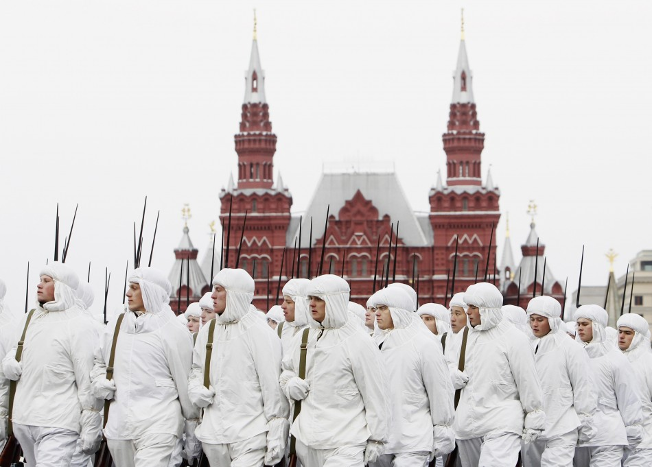 Russian servicemen in historical uniforms take part in a military parade in Moscow's Red Square
