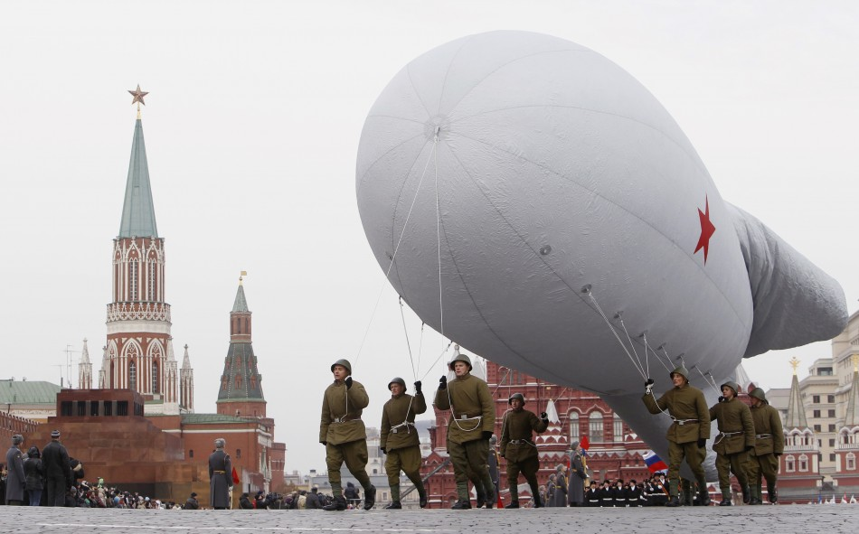 Russian servicemen prepare a World War Two balloon, as part of a military parade in Moscow's Red Square