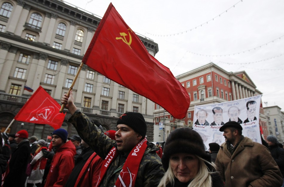 Communist supporters carry flags and banners during a march through central Moscow on Revolution Day
