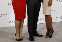 """Actor Daniel Craig poses with Berenice Marlohe and Naomie Harris while launching the start of production of the new James Bond film """"SkyFall"""" at a restaurant in London"""