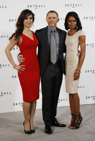 Actor Daniel Craig poses with Berenice Marlohe and Naomie Harris while launching the start of production of the new James Bond film quotSkyFallquot at a restaurant in London