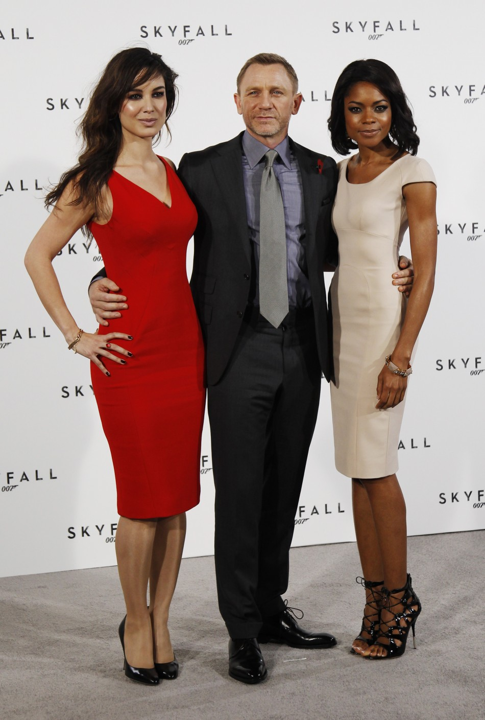 "Actor Daniel Craig poses with Berenice Marlohe and Naomie Harris while launching the start of production of the new James Bond film ""SkyFall"" at a restaurant in London"
