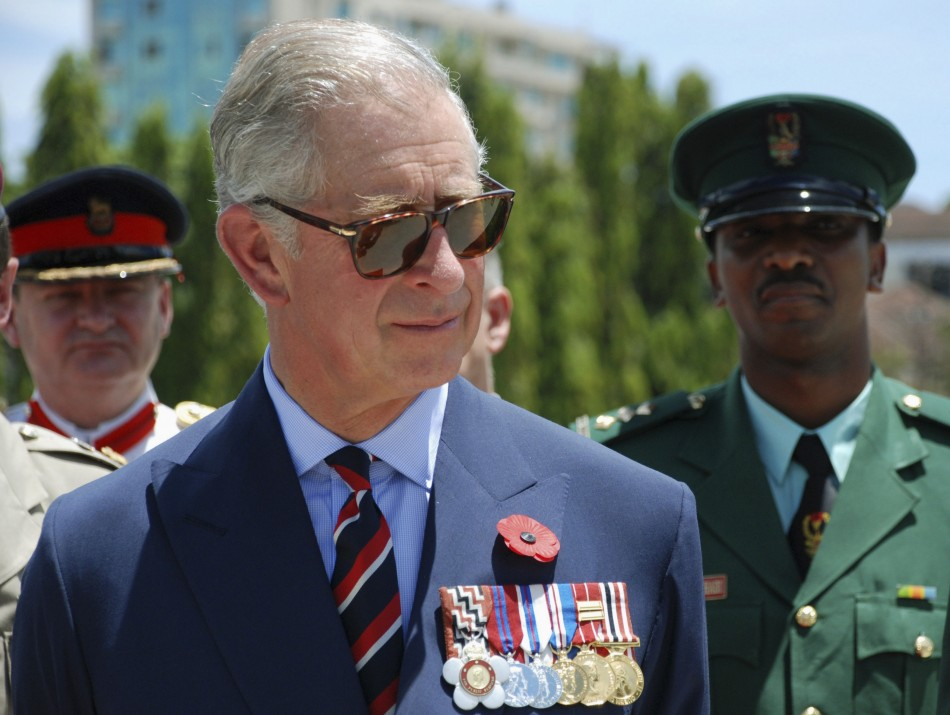 Britain's Prince Charles listens to members of TPDF after a parade in Dar es Salaam