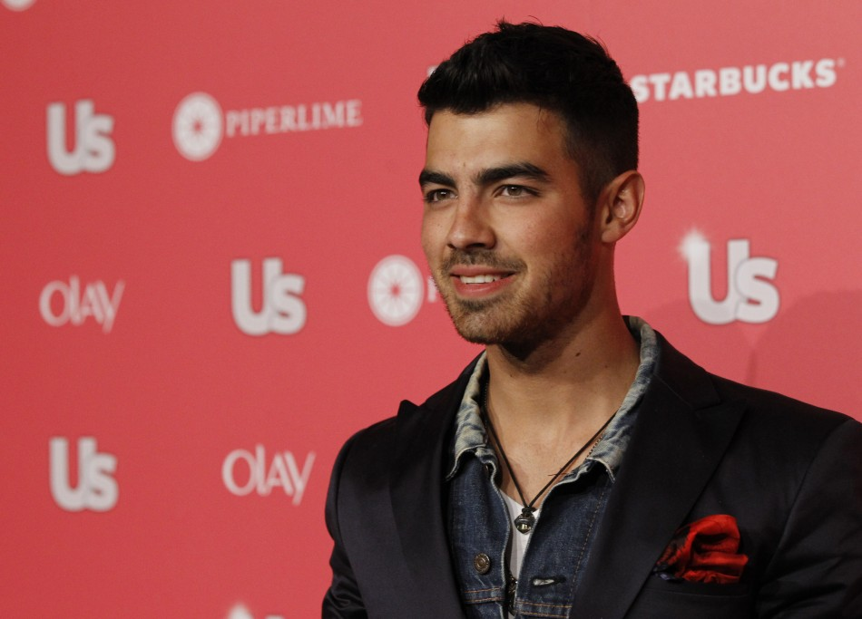 Jonas poses at the US Weekly Hot Hollywood Style issue party in Hollywood