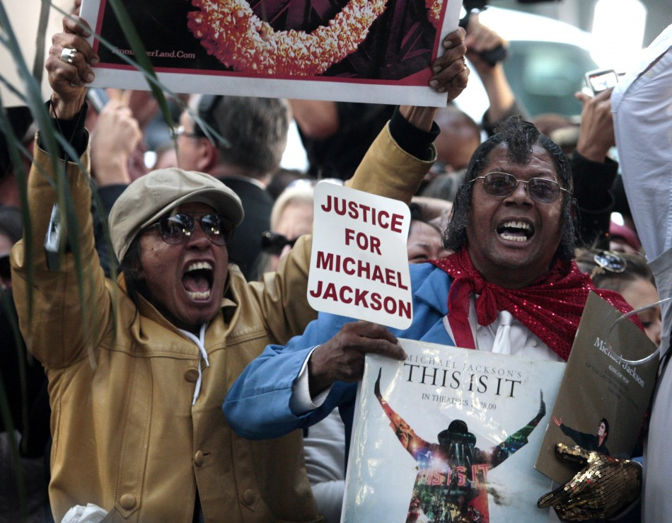Fans of Michael Jackson react outside the courthouse