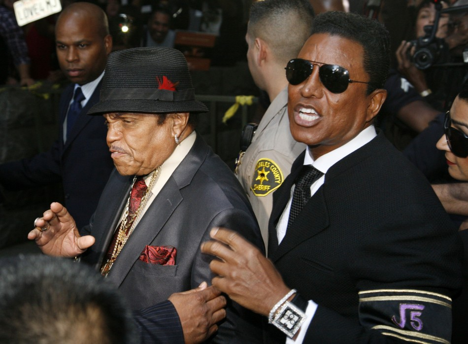 Michael Jackson's father Joe (L) and brother Jermaine Jackson leave the courthouse