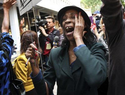 A fan of Michael Jackson react outside the courthouse