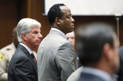 Dr. Conrad Murray stands in court