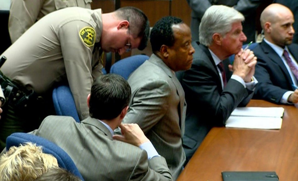 Dr. Conrad Murray is handcuffed as he is remanded into custody