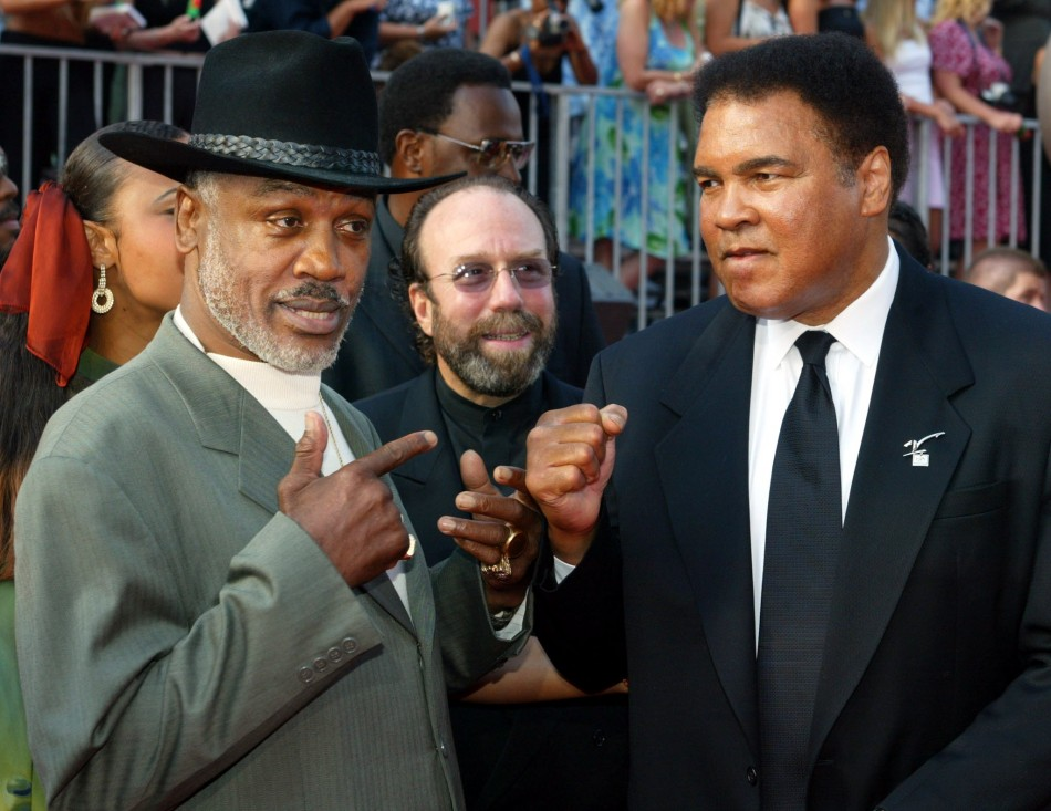 Boxers Joe Frazier L and Muhammad Ali pose together as they arrive at the 10th annual ESPY Awards in 2002.