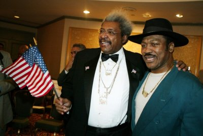 Don King and Joe Frazier pose in New York