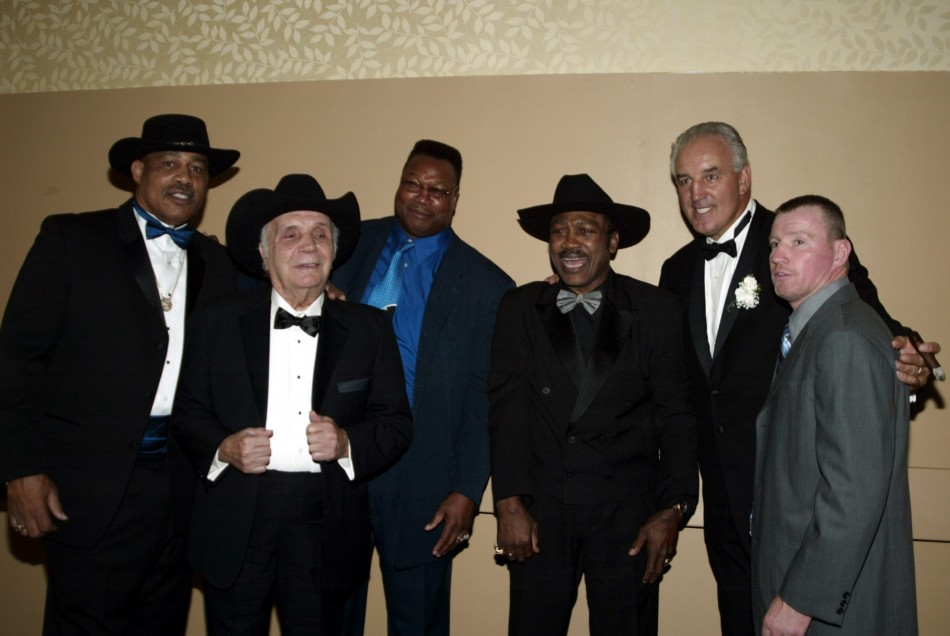 Boxers including Wepner, Lamotta, Holmes, Frazier and Cooney pose at a fundraiser benefit in New York.