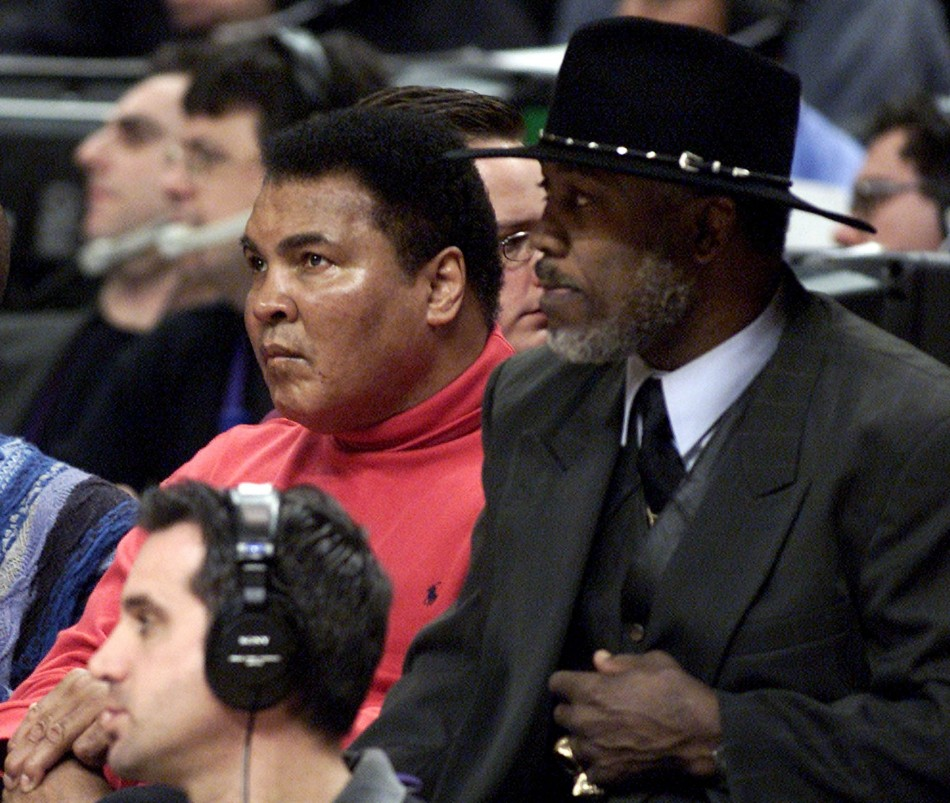 Muhammad Ali (L) and Joe Frazier watch the 2002 NBA All-Star game at the First Union Center in Philadelphia.