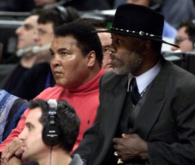 Muhammad Ali L and Joe Frazier watch the 2002 NBA All-Star game at the First Union Center in Philadelphia.