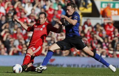 Liverpools Adam challenges Manchester Uniteds Jones during their English Premier League soccer match at Anfield in Liverpool 15102011