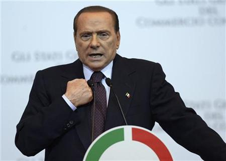Italy Prime Minister Silvio Berlusconi gestures as he speaks during a meeting in Rome