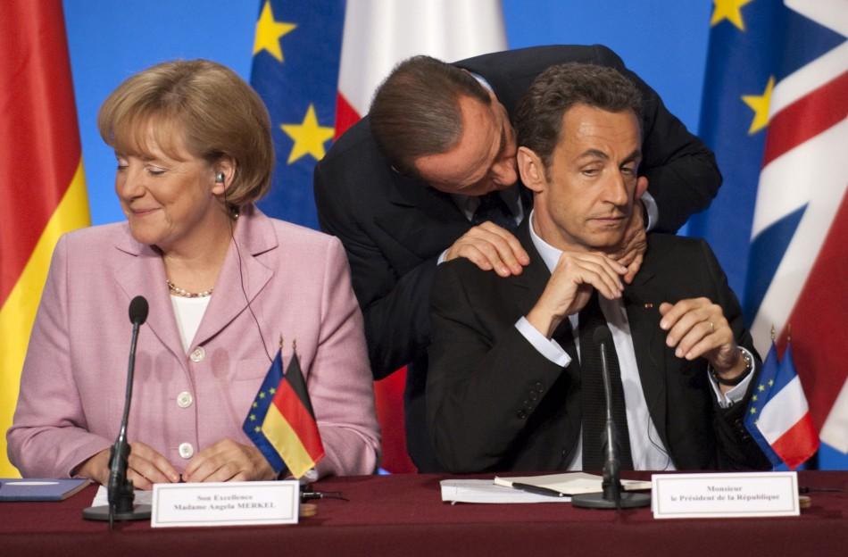 Belusconi massaging a tensed Sarkozy