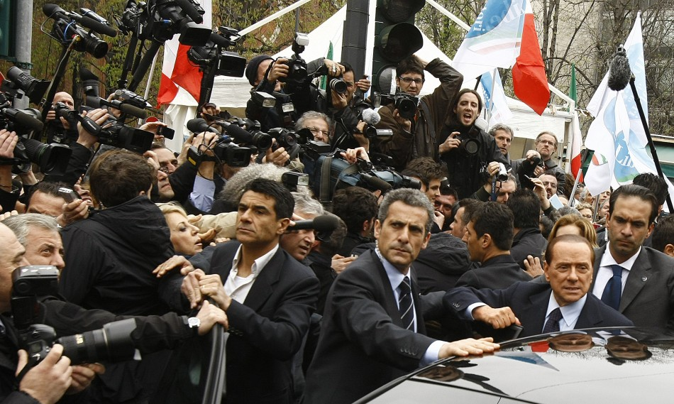 Italy's Prime Minister Silvio Berlusconi leaves the Justice Palace in Milan