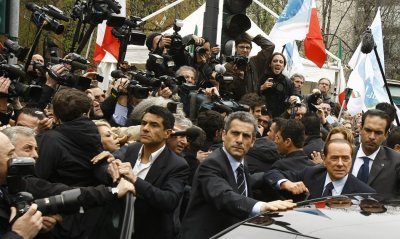 Italys Prime Minister Silvio Berlusconi leaves the Justice Palace in Milan