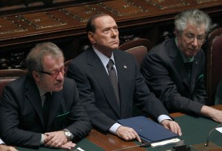 Italian Prime Minister Berlusconi looks on next Justice Minister Maroni and League North Party leader Bossi during a finance vote at the parliament in Rome