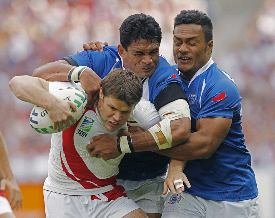 Eliota Fuimaono-Sapolu (right) has been banned for three weeks by the Rugby Football Union (RFU) after being found guilty on two charges of posting critical comments on Twitter about the RWC and the IRB.