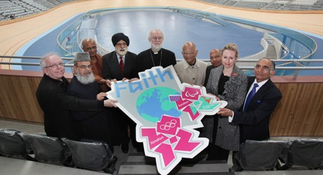 The faith leaders, belonging to nine different faiths, help unveil the new London 2012 Faith badge inside the Velodrome.