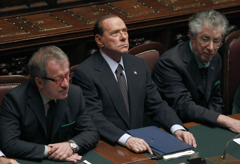 Italian Prime Minister Silvio Berlusconi (C) looks on next Justice Minister Roberto Maroni (R) and League North Party leader Umberto Bossi during a finance vote at the parliament in Rome