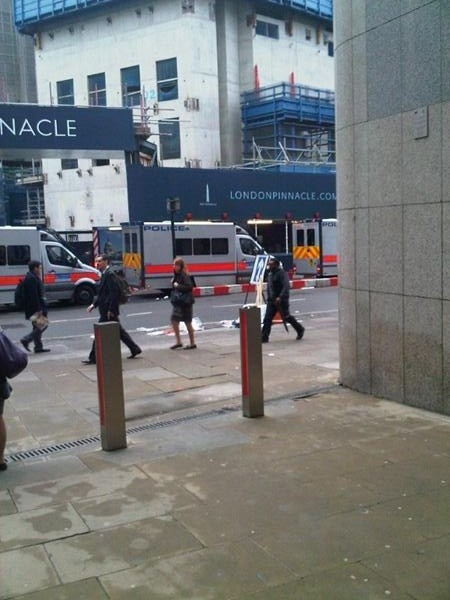 Police Vans Line the Road Near the Gherkin