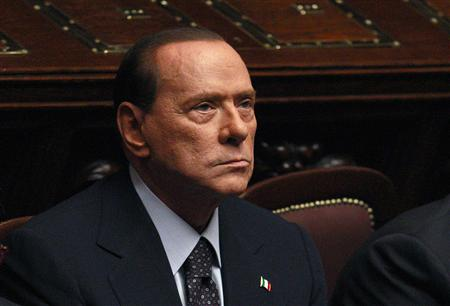 Italian PM Berlusconi looks on during a finance vote at the parliament in Rome
