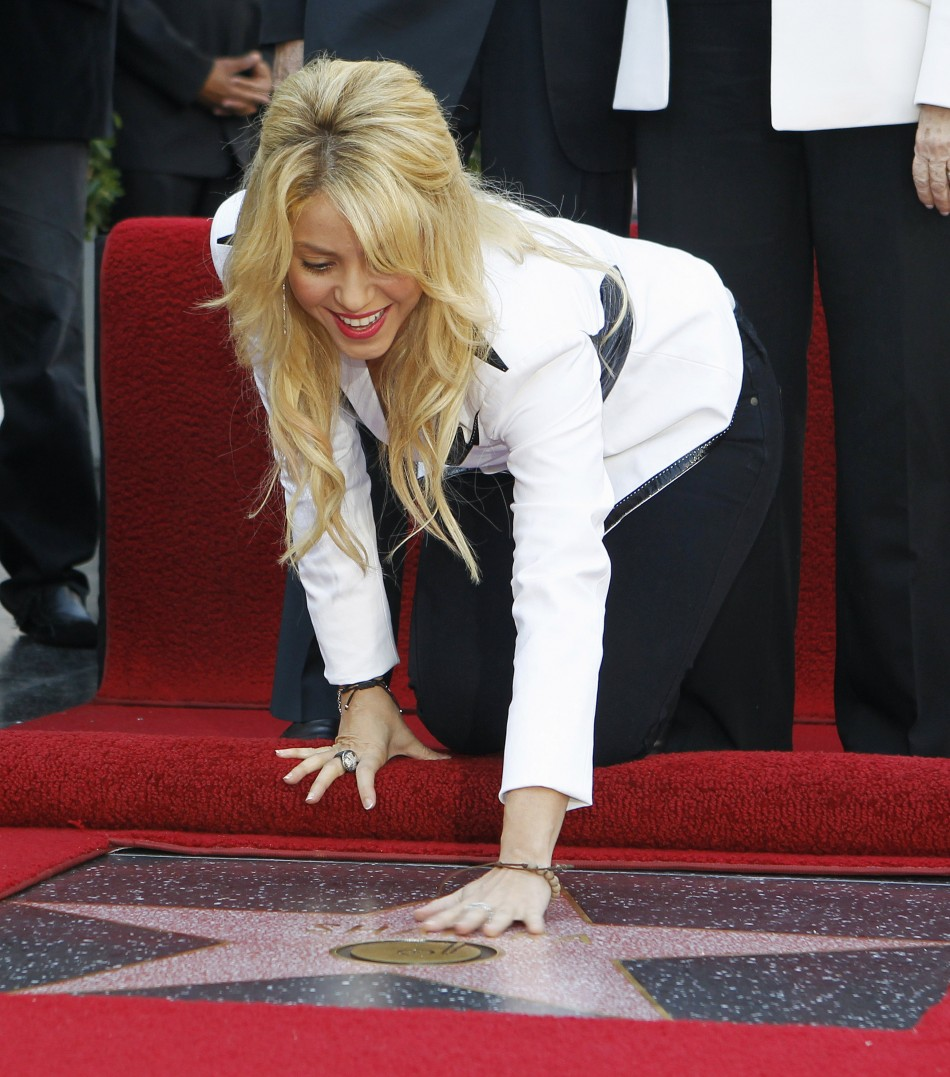 Colombian singer Shakira touches her star after it was unveiled on the Hollywood Walk of Fame in Hollywood