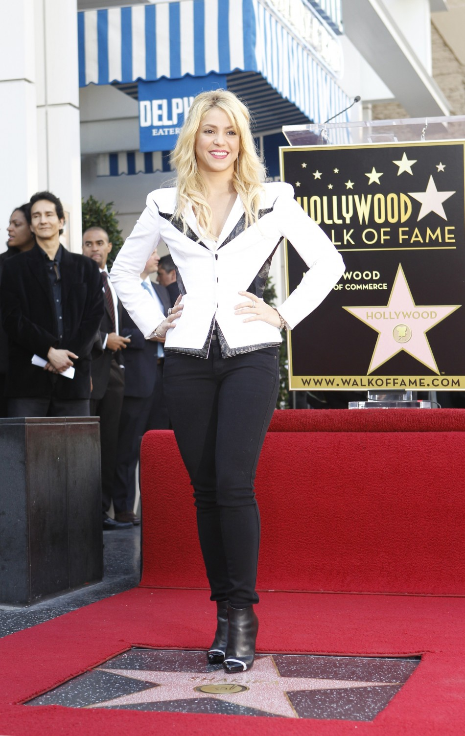 Shakira poses on her star after it was unveiled on the Walk of Fame in Hollywood