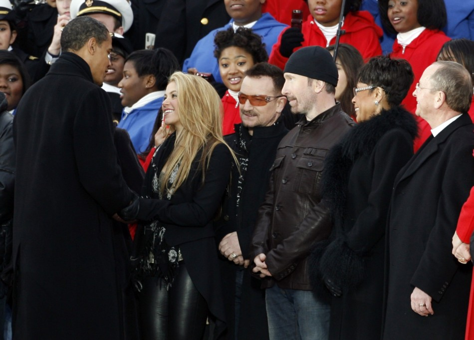 U.S. President Barack Obama greets singer Shakira, U2's Bono, U2's The Edge, singer Bettye LaVette and Episcopal Bishop Reverend Gene Robinson in Washingtnon.