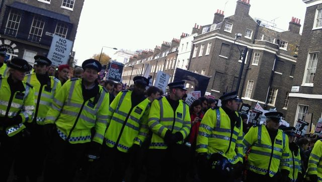 Police line with student protesters