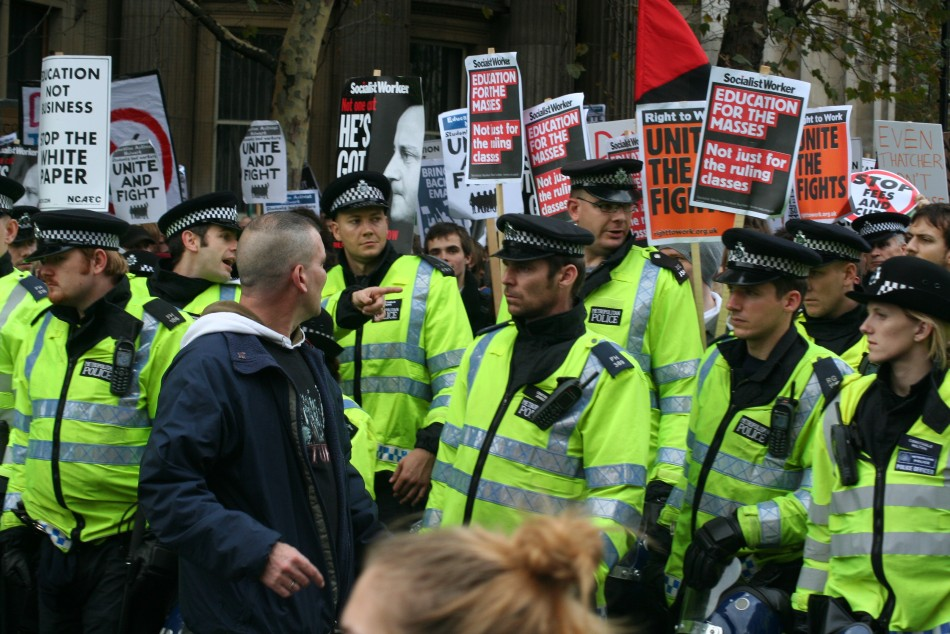 Police officer and protester stare at each other