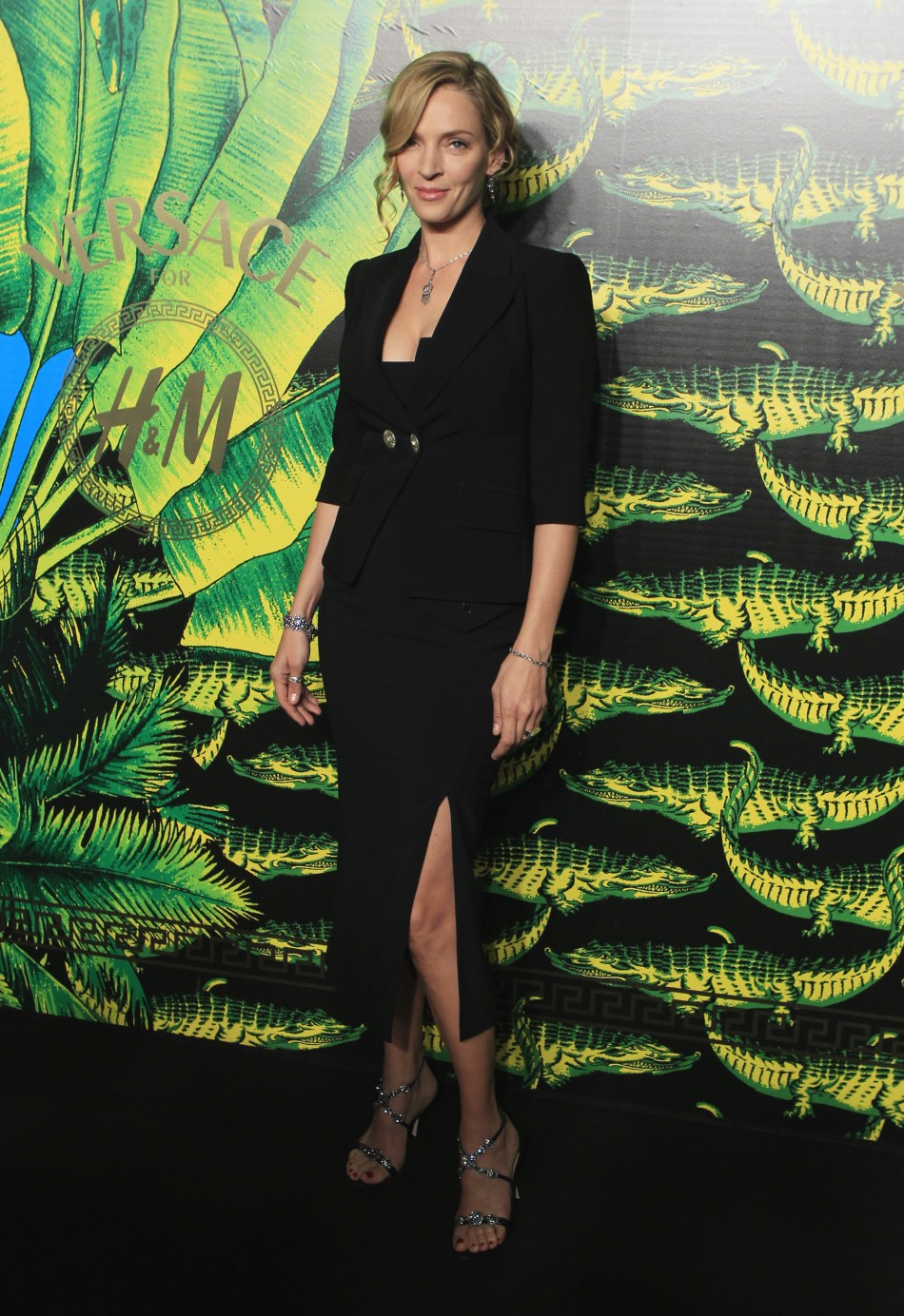 Actress Uma Thurman arrives at a party to celebrate the upcoming launch of the Versace for HM collection in New York