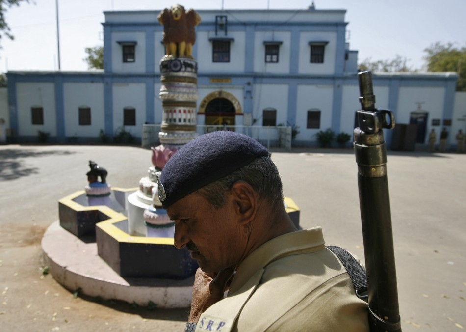 An Indian security personnel stands guard outside the Sabarmati central jail in Ahmedabad