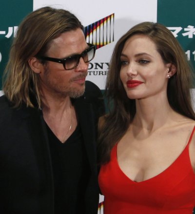 U.S. actor Brad Pitt and his partner Angelina Jolie pose during the Japan premiere of Pitts film quotMoneyballquot in Tokyo