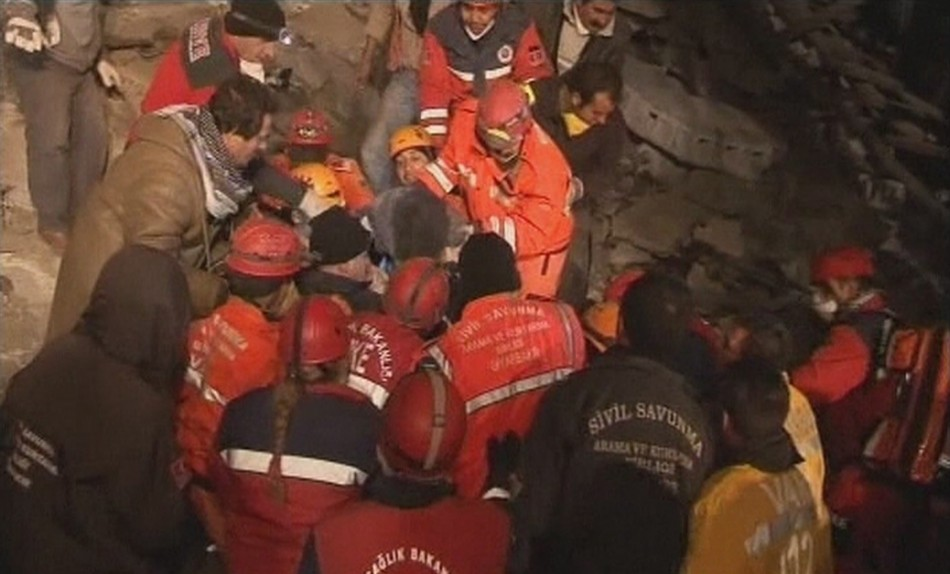 Rescuers assist earthquake survivor Konnai after earthquake south of the city of Van